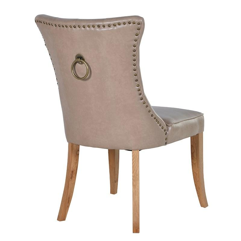 Putty faux leather dining chair with lion knocker for Faux leather dining chairs